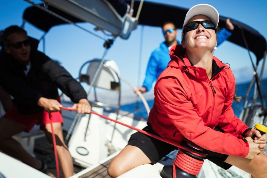 Sailing Terms To Know: Woman & Team Working on Sailboat